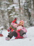 Little girl enjoying a sleigh ride Royalty Free Stock Photography