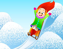 Little girl enjoying a sleigh ride. Child sledding. Toddler kid riding a sledge. Children play outdoors in snow. Kid sled in the A Stock Photo