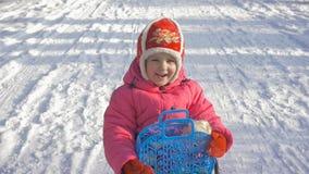 Little girl enjoying a sleigh ride. Child sledding. stock video