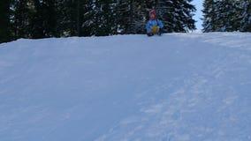 little girl enjoying a sleigh ride child sledding stock footage - Christmas Vacation Sled