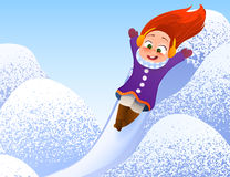 Little girl enjoying a sleigh ride. Child sledding. Toddler kid riding a sledge. Children play outdoors in snow.  Royalty Free Stock Images