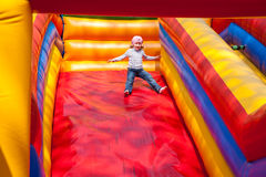 Little girl enjoying the slide Royalty Free Stock Photography