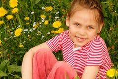 Little girl enjoying Spring day Stock Image