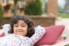 Little Girl Enjoying Spring on a Hammock. Little Girl on a Hammock in Spring Stock Photography