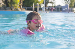 Little girl enjoying the summer at swiming pool Royalty Free Stock Photo