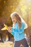 Little Girl Enjoying Sunny Autumn Day royalty free stock photography