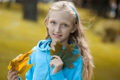 Little Girl Enjoying Sunny Autumn Day royalty free stock image