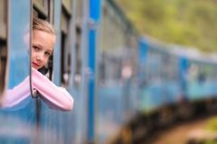 Train in Sri Lanka. Little girl enjoying train ride from Ella to Kandy among tea plantations in the highlands of Sri Lanka royalty free stock photo
