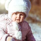 Little girl enjoys the arrival of winter Royalty Free Stock Photography