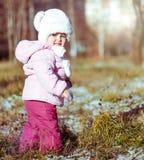 Little girl enjoys the arrival of winter Stock Image