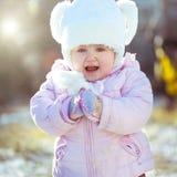 Little girl enjoys the arrival of winter Stock Photos