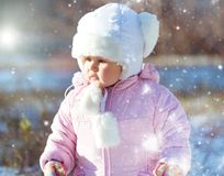 Little girl enjoys the arrival of winter Stock Photo