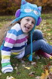 Little Girl Enjoys Autumn Royalty Free Stock Photography