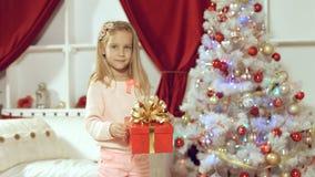 Little girl enjoys gift for the New Year Stock Image