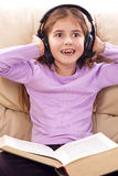 Little girl enjoys music Royalty Free Stock Photos