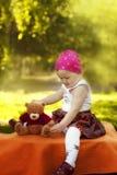 Little girl enjoys playing with Teddy Bear Stock Photos