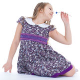Little girl enjoys the smell of flowers Stock Photo