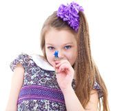 Little girl enjoys the smell of flowers Stock Photography