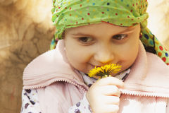 Little girl enjoys the smell of flowers Recreation, summer, nat Royalty Free Stock Photos