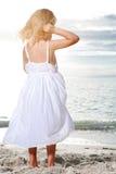 Little girl enjoys sunny day at the beach. Stock Photo