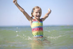Little girl enjoys sunny summer day. Stock Photos
