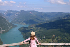 Little girl enjoys the view from the viewpoint Tara mountain Royalty Free Stock Image