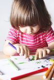 Little Girl Enthusiastic Drawing Stock Photo