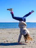 Little girl equilibrium on sand Stock Photos
