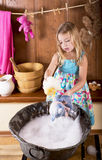 Little girl erases bears Stock Images