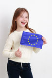 Little girl and european flag Royalty Free Stock Images