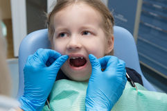 The little girl examined  in the dental clinic Stock Image