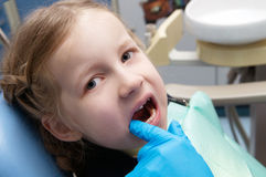 The little girl examined  in the dental clinic Royalty Free Stock Photo
