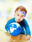 Little girl examines the globe. Royalty Free Stock Photo