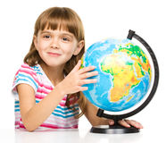 Little girl is examining globe Royalty Free Stock Photo