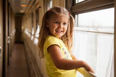 Little girl travelling by train stock images