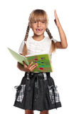 Little girl with exercise books Stock Photo