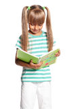 Little girl with exercise books Royalty Free Stock Photos