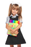Little girl with exercise books Stock Images