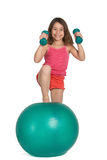 Little girl exercising Royalty Free Stock Photo