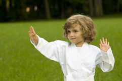 Little girl exercising in the garden Stock Photos