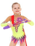 Little girl exercising with gymnastic mace Royalty Free Stock Photos