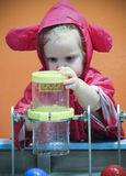 A Little Girl Experiments with Water at the Discovery Children`s Stock Photography