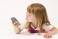 Little girl explores phone Royalty Free Stock Image