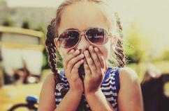 Little girl expressing amazement. In sunglasses Stock Photos