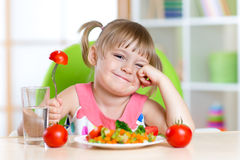 Little girl with expression of disgust against Stock Photo