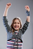 Little girl exulting raising her arms Royalty Free Stock Photography