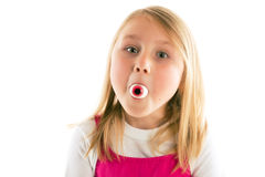 Little girl with eye in her mouth Royalty Free Stock Photos