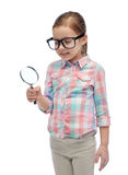 Little girl in eyeglasses with magnifying glass Royalty Free Stock Photos