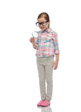 Little girl in eyeglasses with magnifying glass Royalty Free Stock Images