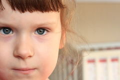 Little girl face. Close up with a blank space for text Stock Images